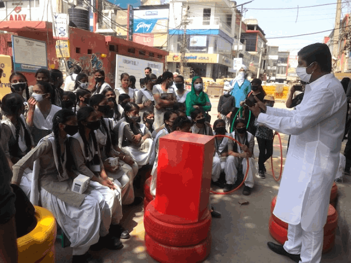 Aditya Mukarji talking to students
